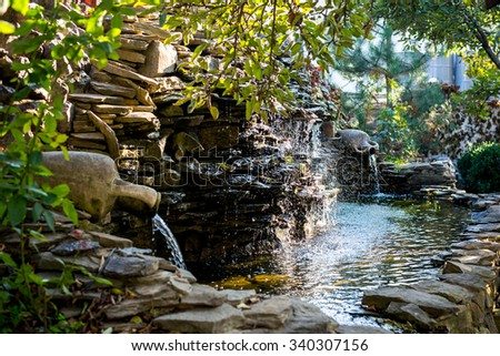 Landscape design. Water cascade - stock photo