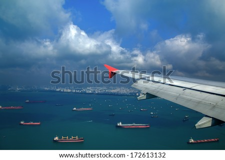 Landscape from bird view of Cargo ships entering one of the busiest ports in the world, Singapore. - stock photo