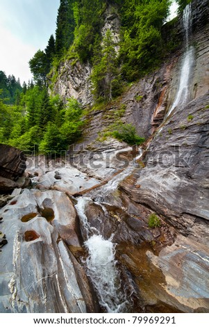 Landscape from Latoritei waterfall in Romanian mountains with Latoritei river