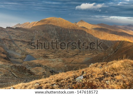 Landscape from the rocky Fagaras Mountains in Romania.Dara Peak ( 2501m ) in the background