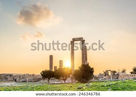 Landscape grass prospects the Temple of Hercules at sunset in Amman Citadel, Jordan. Amman Citadel is known in Arabic as Jabal al-Qal'a.  - stock photo