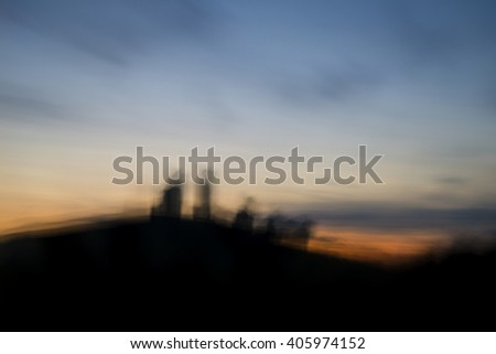 Landscape image of enchanting fairytale castle ruins during beautiful sunset with blur filter applied - stock photo