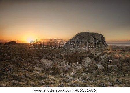 Landscape image of King Arthurs Stone in the Gower Peninsula, South Wales. Taken at sunset. - stock photo