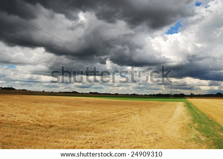 Landscape in Bavaria, cloudscape and powerline.