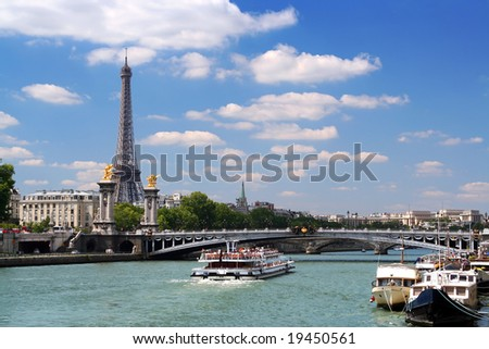 Landscape in Paris. Eiffel Tower, cruise boat on the Seine under Alexandre III bridge - stock photo