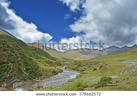 landscape in plateau with river and pasture meadow - stock photo