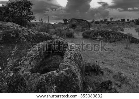 Landscape in the Barruecos Natural Area (Spain). In the foreground there is an anthropomorphic tomb of several that exist in this area. They are archeological remains of IV century AD approximately.