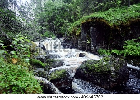 landscape in the spring forest small waterfall stream - stock photo