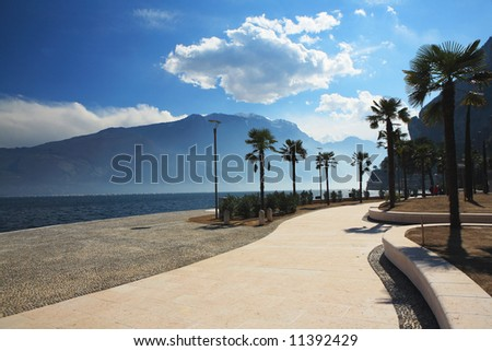 landscape Itali lago di Garda mountain blue sky road palm - stock photo