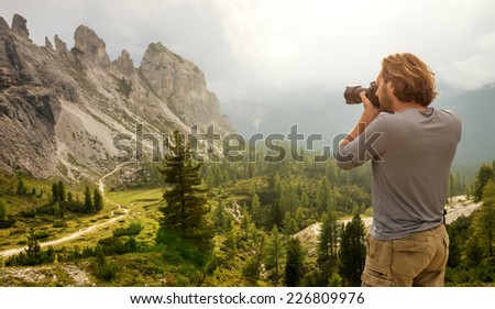 Landscape Italy, Dolomites - Men hiking Photographer take a picture - stock photo