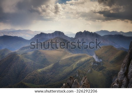 Landscape. Mountain ridges at against the sky with clouds - stock photo