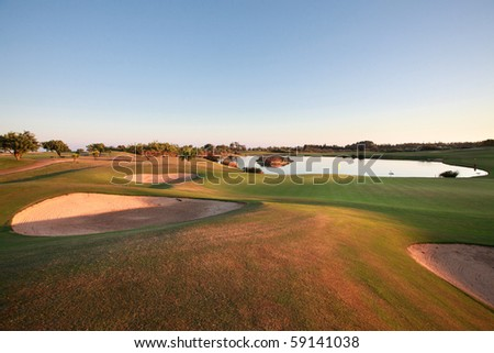Landscape of a golf course at dusk.