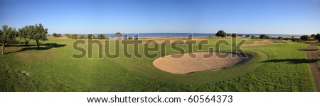 Landscape of a golf course on the coastline.