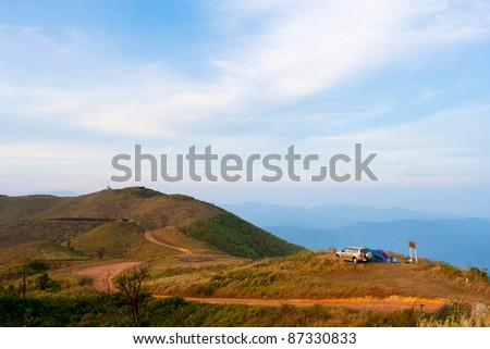 Landscape of a mountain in tropical rainforest with a SUV car. - stock photo