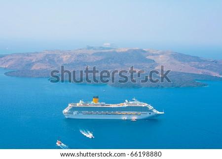 Landscape of Aegean sea with big passenger cruise ship near volcano on island of Santorini, Greece. Caldera view. - stock photo