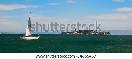 Landscape of Alcatraz in San Francisco showing bay with sailboats - stock photo