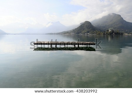 Landscape of Annecy lake and mountains in Savoy, France - stock photo