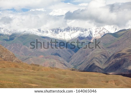 Landscape of arid Tien Shan mountains with snow peaks, Kyrgyzstan