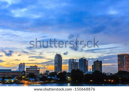 Landscape of Bangkok City with Chao Praya River in dusk