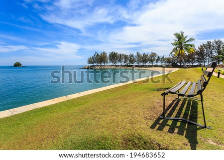 Landscape of beach with palm and bench in day time at brunei