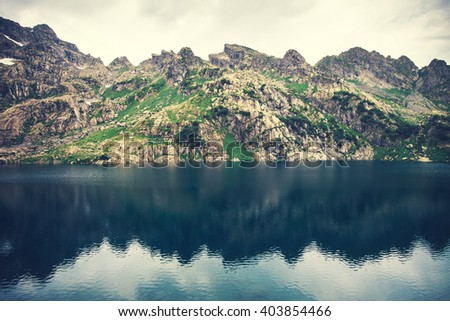 Landscape of beautiful Lake with Rocky Mountains mirror reflection Summer Travel serene scene
