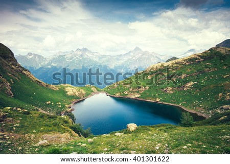 Landscape of beautiful Lake with Rocky Mountains Summer Travel serene aerial view