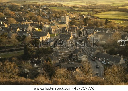 Landscape of Corfe village in Dorset during beautiful golden sunset - stock photo