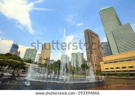 Landscape of downtown kuala lumper with blue sky - stock photo