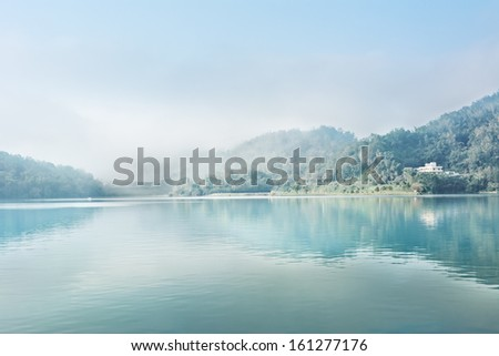 Landscape of famous Sun Moon Lake in the morning with mist in Taiwan, Asia. - stock photo