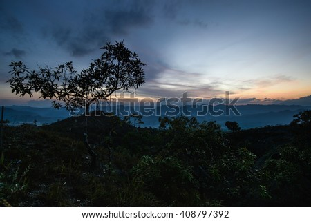 Landscape of high mountain with sunset at horizon of sky