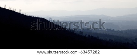 landscape of hills through the fog in riglos, spain - stock photo