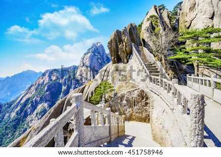 Landscape of Huangshan (Yellow Mountains). Huangshan Pine trees. Located in Anhui province in eastern China. It is a UNESCO World Heritage Site, and one of China's major tourist destinations. - stock photo