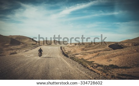 Landscape of Iraqi road in the desert with a bike inside