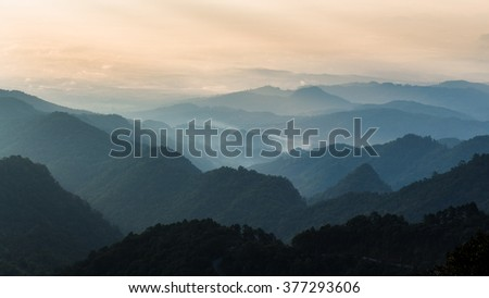 Landscape of layer of mountain in dark tone - stock photo