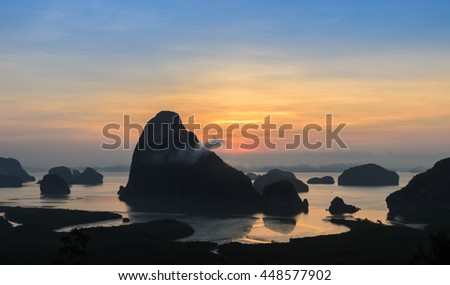 "Landscape of limestone karsts in Phang nga bay at sunrise.  Unseen place of ""Samed Nangshe"" or ""Samet Nangchee"" in Phang Nga province, Thailand. - stock photo"