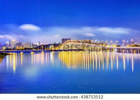 Landscape of Macau at night. Lago Nam Van. In the distance is Macau-Taipa Bridge (Aodang Bridge). Located in Macau.