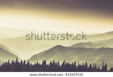 Landscape of misty mountain hills at summer. Filtered image:cross processed retro and soft focus effect.  - stock photo