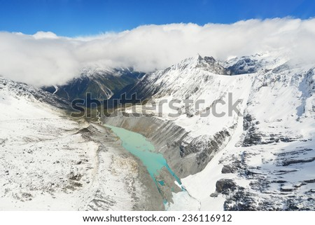 landscape of Mount cook with sea of mist from helicopter - stock photo
