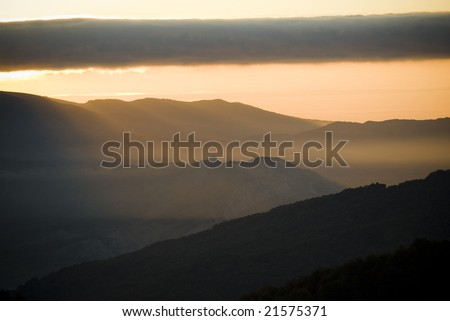 Landscape of mountain to the dawn with mist and sun-shines