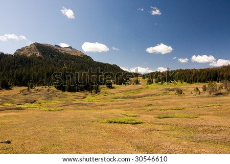 Landscape of mountains and meadows