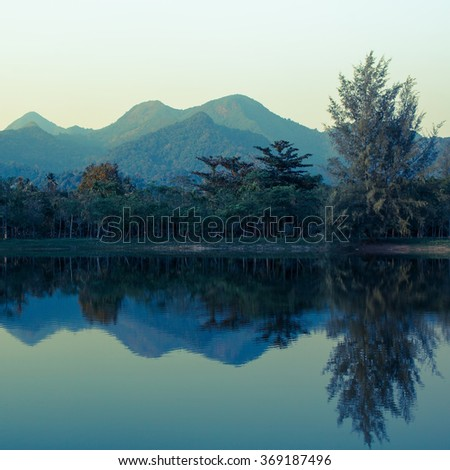 Landscape of mountains reflected in the lake. Thailand.