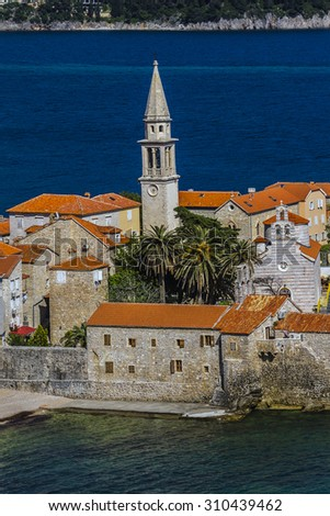 Landscape of Old town Budva: Ancient walls and red tiled roof. Montenegro, Europe. Budva - one of the best preserved medieval cities in the Mediterranean and most popular resorts of Adriatic Riviera. - stock photo
