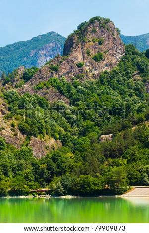 Landscape of Olt Valley with Olt river and mountains in Romania - stock photo
