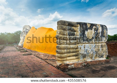 Landscape of Reclining Buddha in Thailand, South East Asia. Reclining Buddha is one of statutory of Buddhism. Buddhism was founded and taught by Buddha in India. - stock photo