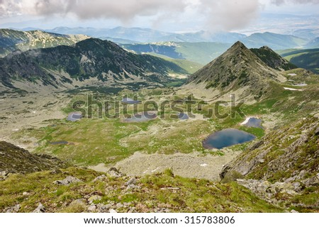 Landscape of Retezat National Park mountains in South Carpatians, Transylvania, Romania, Europe. Small lakes down there. - stock photo
