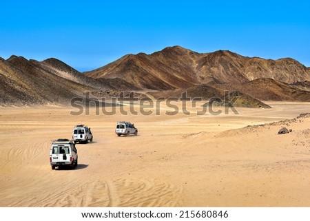 Landscape of Sahara desert with jeeps for safari. - stock photo