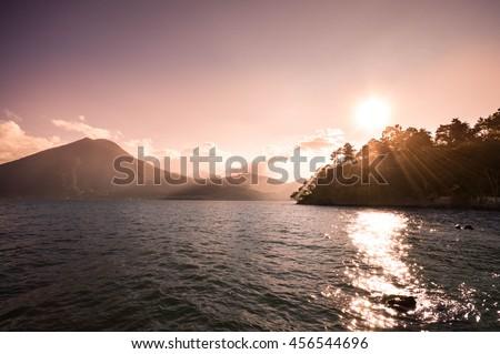 Landscape of San Pedro volcano and Lake Atitlan seen on sunset, Guatemala - stock photo