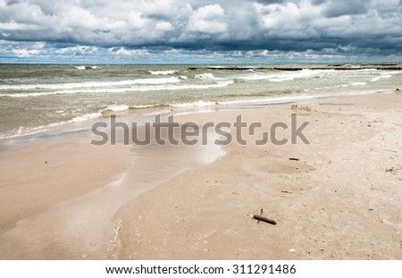 Landscape of sea with waves and cloudy sky. Baltic sea coast near Leba in Poland. - stock photo