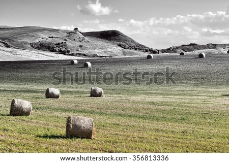 Landscape of Sicily with Many Hay Bales, Retro Image Filtered Style - stock photo