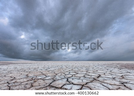 Landscape of soil drought cracked with rain storm  - stock photo